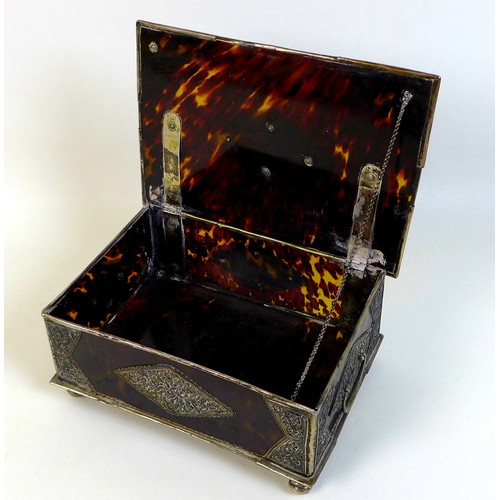 4 - A 19th century South East Asian tortoiseshell and white metal mounted box, the hinged lid with centr...