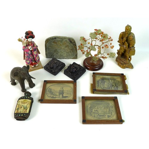 7 - A group of South East Asian collectables, comprising a Chinese soapstone carving of a fisherman, 18c...