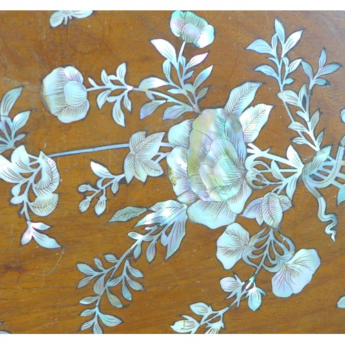 25 - A Chinese hardwood tray with inlaid mother of pearl decoration, late 19th century, depicting sprays ...