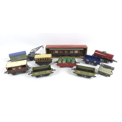 127 - A collection of Hornby 0 gauge rolling stock, wagons, and other accessories, including a crane wagon...