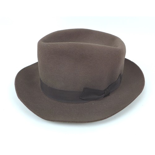 103 - A British Rail cap, dated 1962 size 7 1/8, a vintage felt bowler hat by Falcon, size 7 1/8,  and a J...