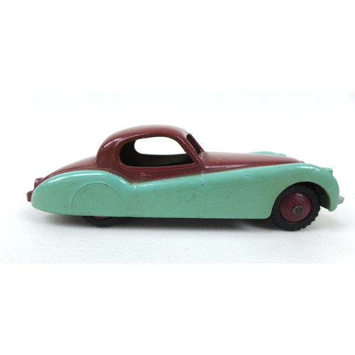 120 - A collection of seven Dinky Toys, most for restoration, comprising a Jaguar XK120 Coupe (157), a Fia...