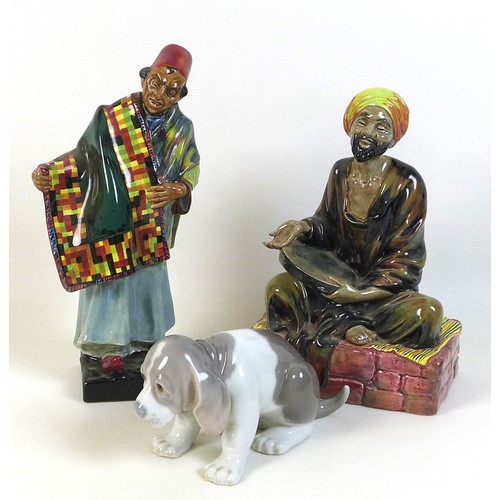42 - Two Royal Doulton figurines, 'Mendicant' H.N. 1365, 'Carpet Seller' H.N. 1464, together with a Lladr...