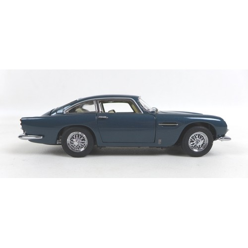 128 - A limited edition Danbury Mint 1:24 scale 1964 Aston Martin DB5, in dark blue, numbered 3020/5000, w...
