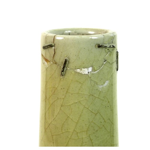 29 - A Chinese porcelain bottle vase, Qing Dynasty, late 19th / early 20th century, with pale green glaze...