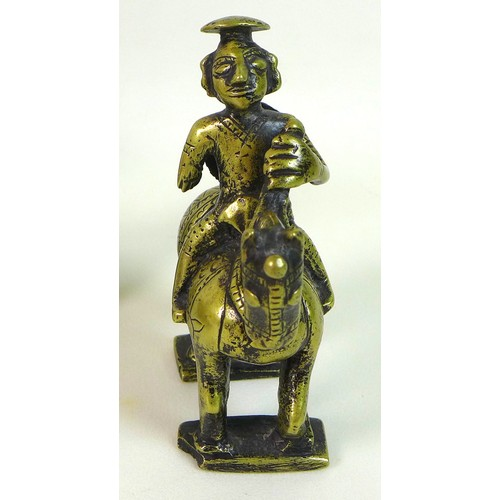 19 - A group of three ethnographic items, comprising a Benin style small bronze sculpture, possibly Afric...