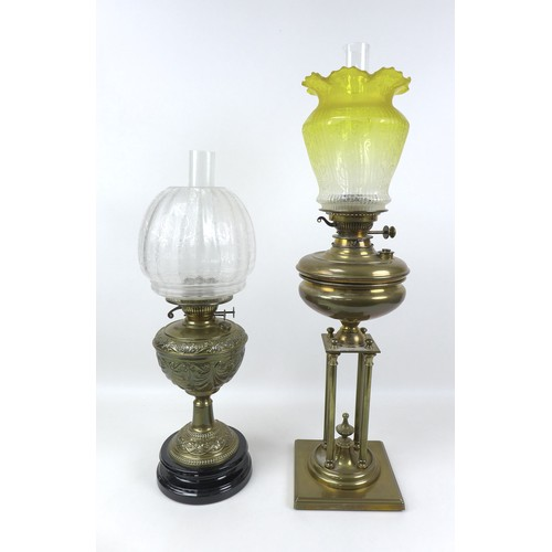 72 - Two Victorian brass paraffin lamps, one with brass reservoir and unusual base with four column on a ...