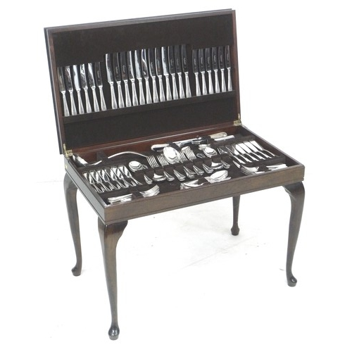 216 - A suite of Osborne silver plated cutlery, in a modern mahogany canteen on stand, bead pattern, twelv...