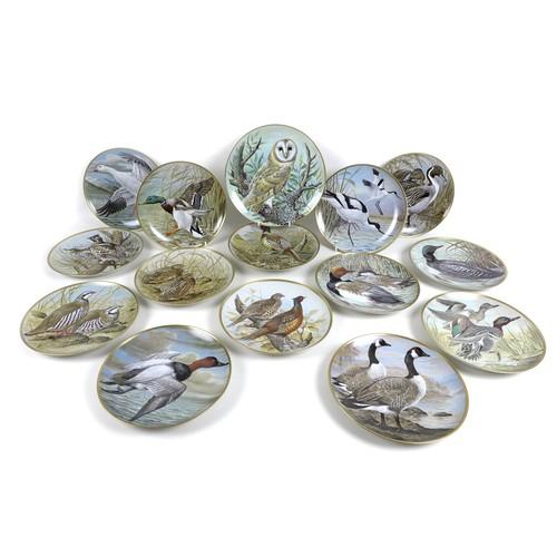63 - A set of twenty four Franklin Porcelain plates, 'Game Birds of the World', designed by Basil Ede, pr...
