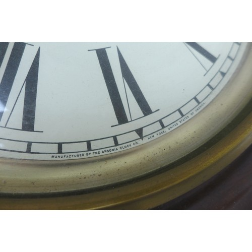 231 - An early 20th century Ansonia drop dial wall clock, with Roman numeral dial, with pendulum, a/f, 43 ...