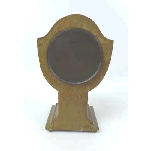 102 - An early 20th century tulip form mantel clock, with Roman numeral dial, walnut veneered case with wa...