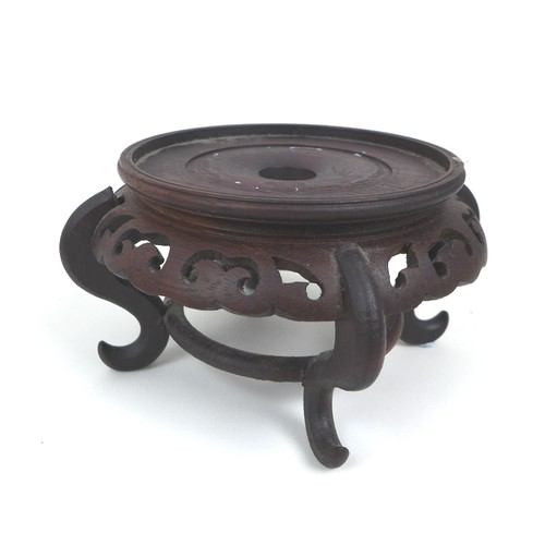 24 - A group of nine oriental hardwood stands, of different styles, largest 18.5cm diameter, 3.5cm high, ...