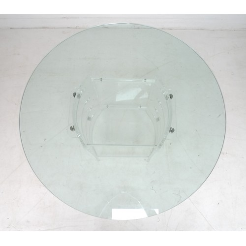 212 - A modern design table, with circular surface and perspex base, 122 by 122 by 73.5cm high....
