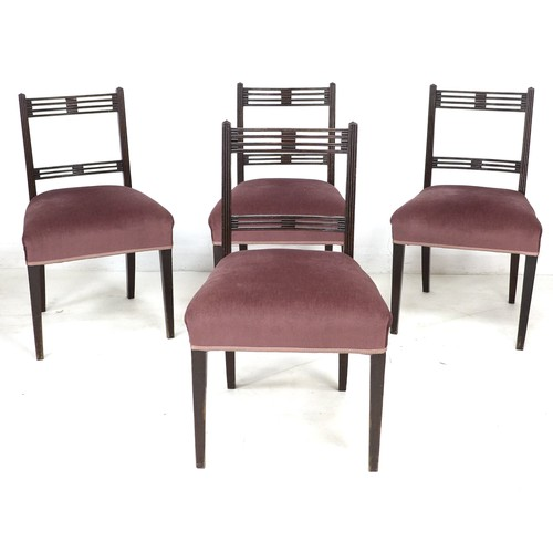243 - A set of four Regency mahogany dining chairs, each with pierced decoration to top rails, upholstered...