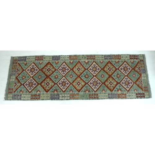 206 - A vegetable dyed wool Choli Kelim runner, with diamond patterned field and geometric borders, 258 by...