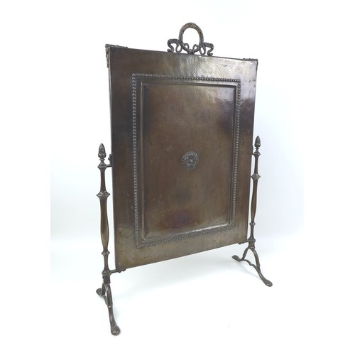 76 - A group of thirteen various vintage metal wares, including two boot scrapes, a firescreen, jamming p...