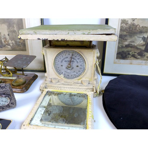 28 - A group of mixed collectables, including a set of weighing scales, a set of postal scales, a brass c...