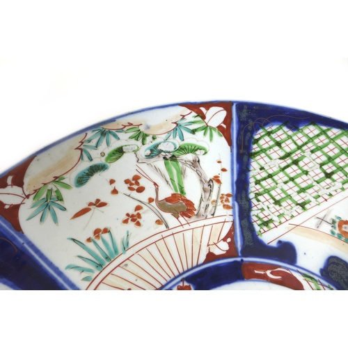 22 - A 19th century Japanese Imari charger, decorated with a fan and origami bird to the centre, 37cm dia...