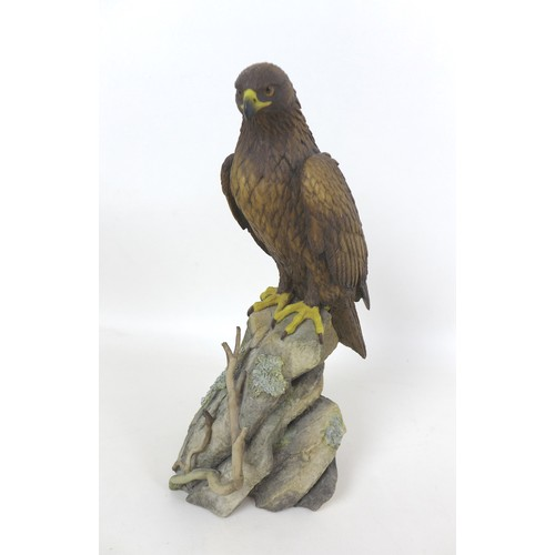 18 - A group of twenty various wildlife figurines, including a Border Fine Arts style Hawk, signed Tom Ma...