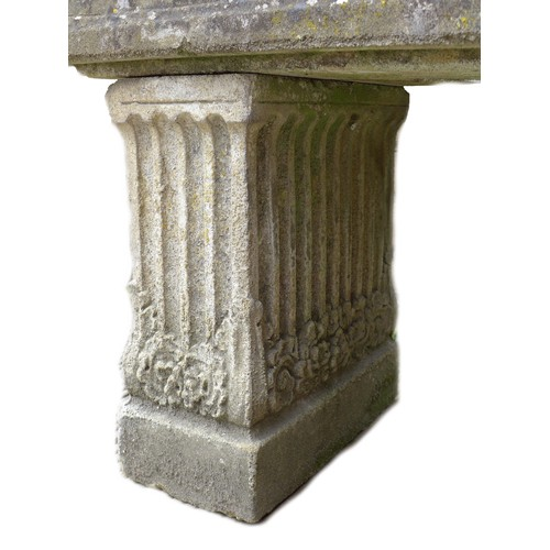 146 - An early 20th century carved stone garden planter, of open coffin form with two drainage holes, deco...