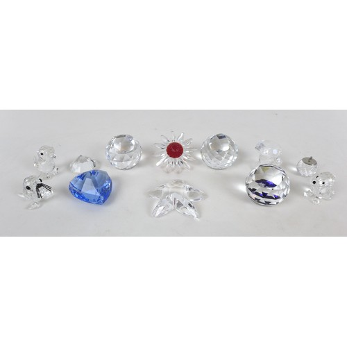 10 - A collection of eleven Swarovski crystal ornaments, including a Red Maguerite Daisy, 4.9 diameter, 3...