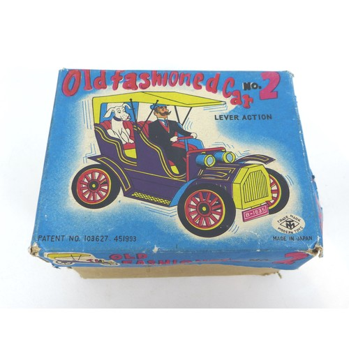 59 - A Japanese Old Fashioned No.2  lever action tin plate model car, with original box, together with a ...