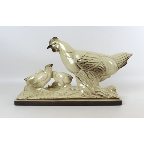 4 - A French mid to late 20th century ceramic figural group, modelled as a hen with chicks and a snail, ...
