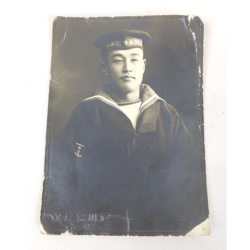 67 - A collection of WWII Japanese ephemera, comprising a Red Cross medal with blue rosette, a Japanese b...
