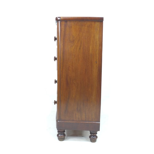 221 - A Victorian bow fronted figured mahogany chest of drawers, with two over three drawers, raised upon ...