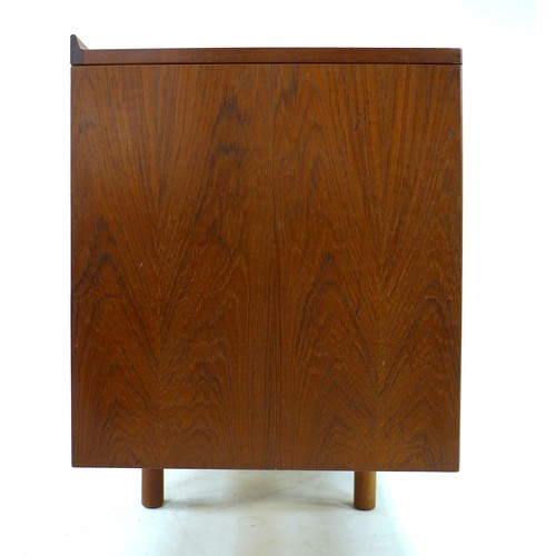 188 - A British teak sideboard, Robert Heritage for Archie Shine, of long low form with small shaped upsta...