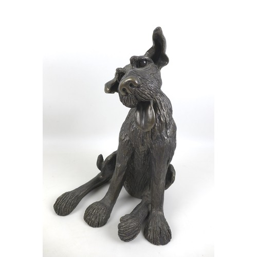 29 - A group of three modern canine sculptures, bronze resin, a larger one of a sitting terrier, 26 by 25...