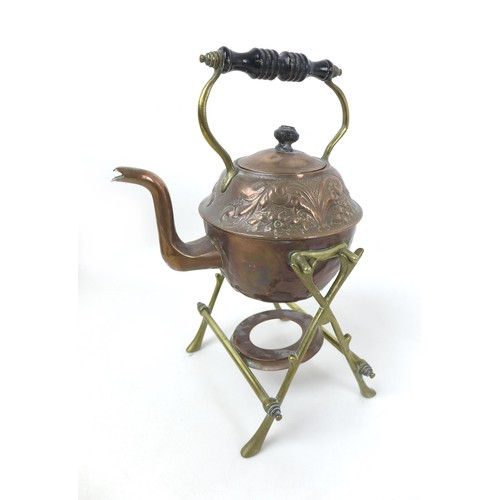 47 - A group of copper and brass items, including an embossed kettle, burner and stand, a crumb brush and...