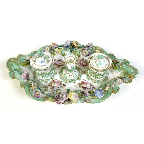 5 - A Continental porcelain desk stand, 19th century, in rococo taste with applied and painted flowers, ...