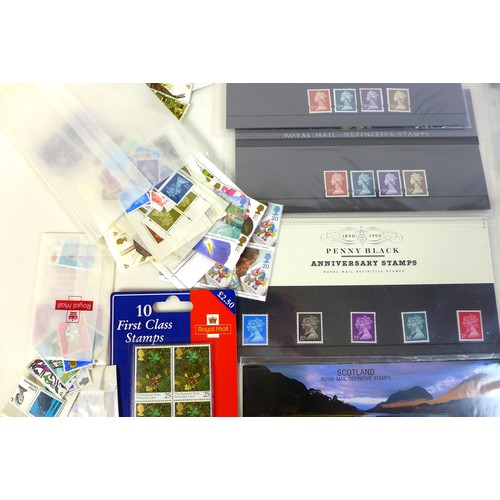 102 - A collection of GB Royal Mail mint unmounted stamps, QEII, in various presentation packs and sets of...