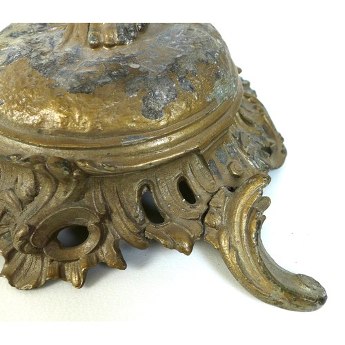 46 - A 19th century cast metal table lamp, possibly French, in the form of a cherub holding the lamp fitt...