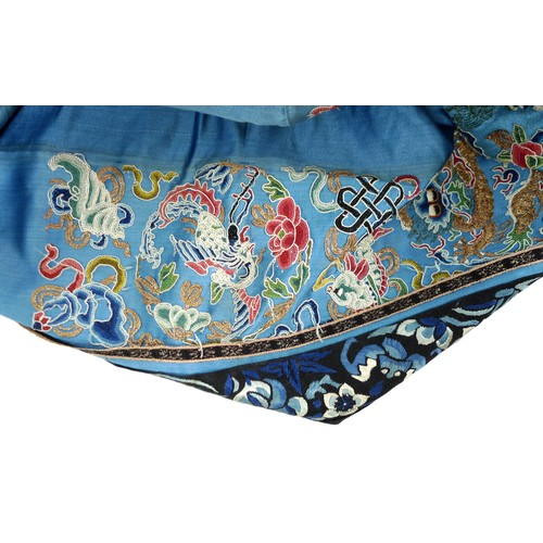 25 - An early 20th century silk Chinese robe, with navy blue ground and intricately embroidered with butt...