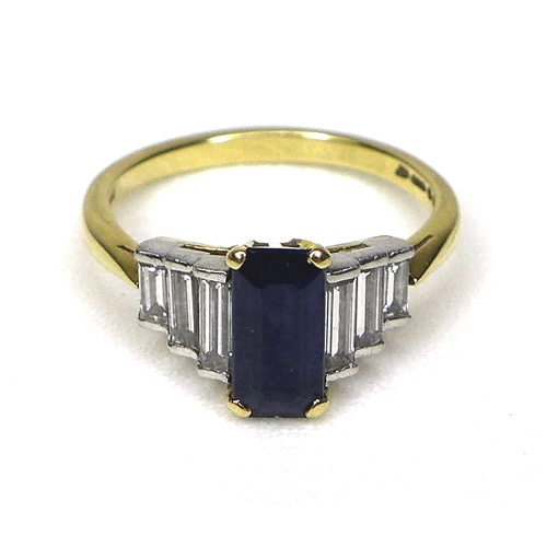 261 - An Art Deco style 18ct gold, sapphire and diamond ring, with raised platinum setting, the central bl...