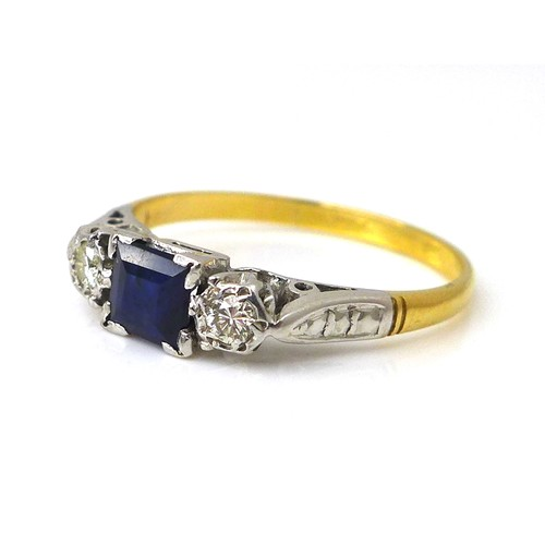 253 - An 18ct gold, platinum, sapphire and diamond ring, the central square cut sapphire, 4.5 by 4.5 by 2....