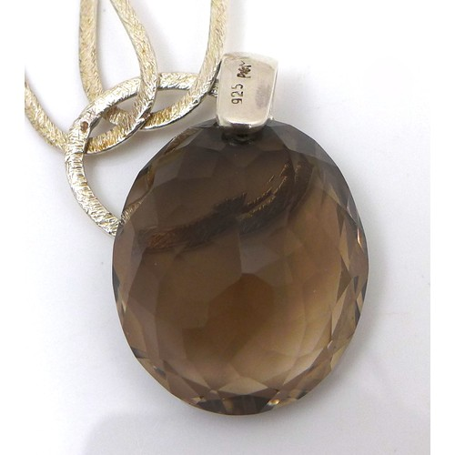 169 - An interesting Modernist design silver necklace with large smokey quartz pendant, the chain of twent...