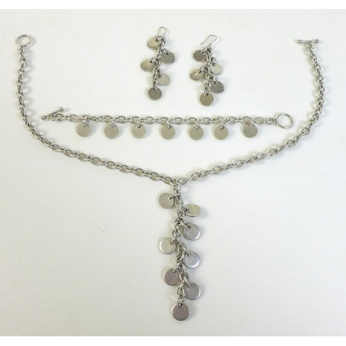 167 - A set of designer silver jewellery, comprising a pair of earrings, bracelet and necklace, of exagera...