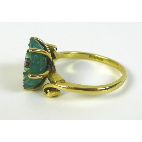 168 - An 18ct gold, jade, and diamond dress ring, the single 0.01ct brilliant cut diamond centering a carv...