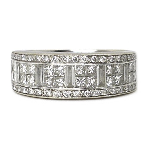 262 - An 18ct white gold and diamond ring, in Art Deco style, circa 1990, with a wide band pave set with a...