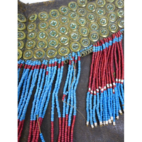 145 - A 19th century East African tribal animal hide loin cloth and beaded knee decoration, possibly Maasa...