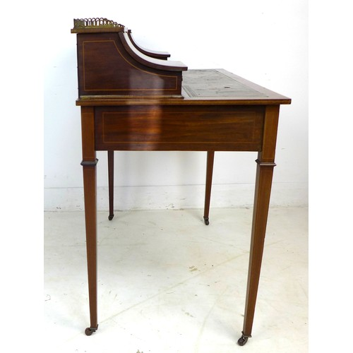 323 - An Edwardian mahogany and line inlaid lady's writing desk, brass gallery and shelf between two conca...