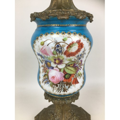 321 - A 19th century continental Sevres style lamp vase, in pale blue with two floral reserves, gilt highl...