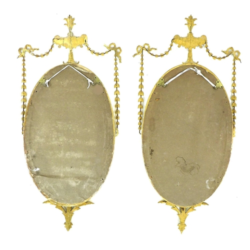 360 - A pair of early 19th century Neoclassical taste gilt composition wall mirrors, in Hepplewhite, Rober...
