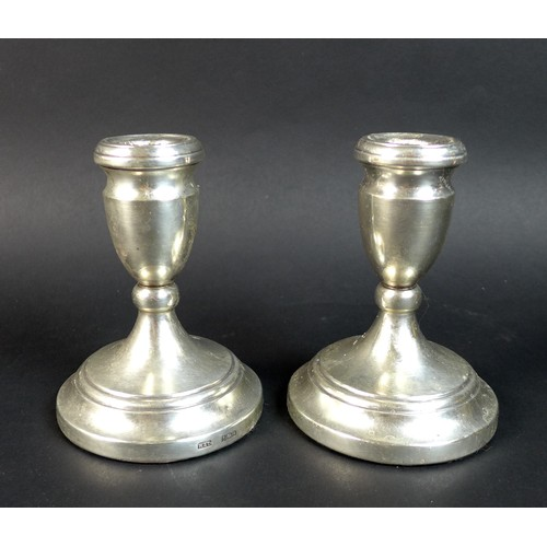 68 - A pair of ER II silver dwarf candlesticks, with weighted bases, Roberts & Dore, Birmingham, 1980, 8....