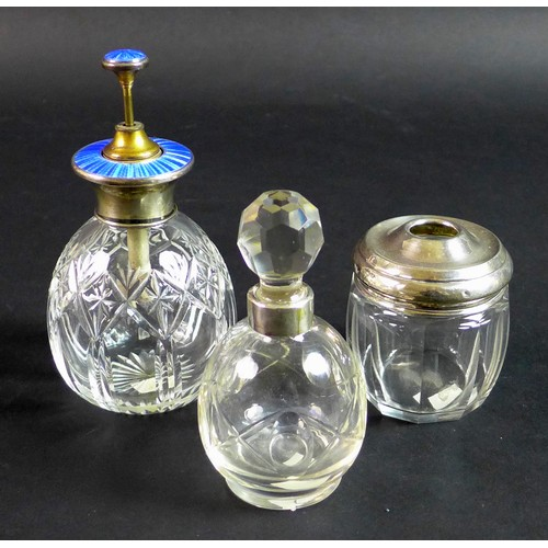 20 - Three silver and cut glass dressing table items, comprising a silver and enamel topped atomiser, sta...