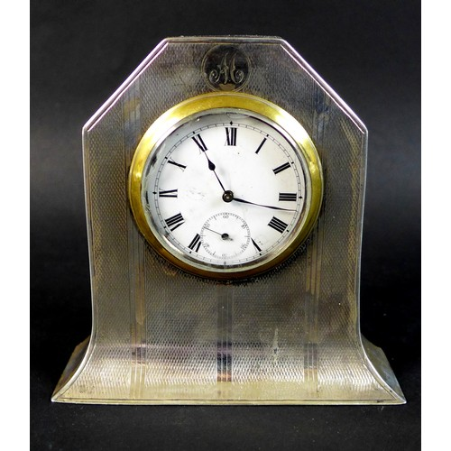 66 - A George V Art Deco silver cased clock, with subsidiary seconds dial, engraved with the initial 'M',...