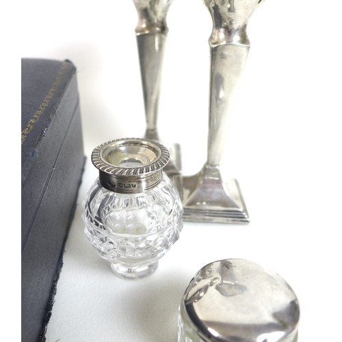 60 - A group of George V silver dressing table items, comprising a cased part set silver and glass backed...